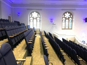 Tip-up auditorium church seating - tiered seating at Holy Trinity Church in Leicester