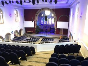 High stacking lightweight chairs and tip-up tiered auditorium seating at Holy Trinity Church in Leicester
