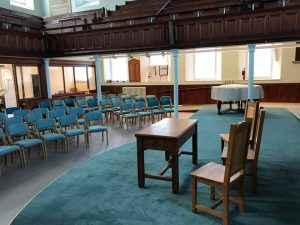 Lightweight wooden stacking upholstered chairs for Taunton united reformed church